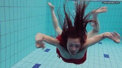 Cute naked girls underwater in the pool Thumb