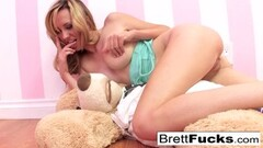Cute Busty Brett plays with a strap-on dildo Thumb