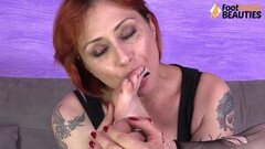 Redhead tears her nylons and licks her sexy feet Thumb