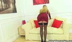 English milf Kat takes off her clothes and plays with dildo Thumb