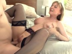 Big boobed blonde milf in stockings and a garter Thumb