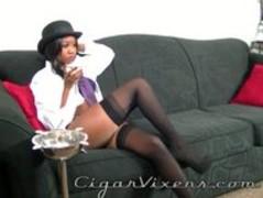 Nina SMOKES a cigar Thumb