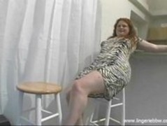 Long hair blonde BBW in short dress striptease Thumb