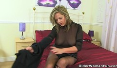 English milf Lucy Gresty needs getting off in satin Thumb