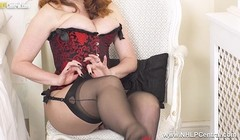 Redhead Milf fingers throbbing pussy in corset nylons heels Thumb