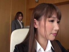 Two Japanese Girls in the Office Having Some Fun While Dressed Thumb